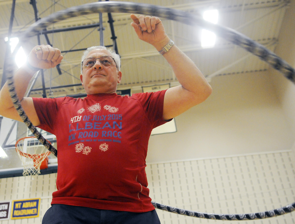 """Frank Yocono of Leeds gets a workout Sunday during the """"hula hoop jam"""" at the Winthrop Middle School gym."""