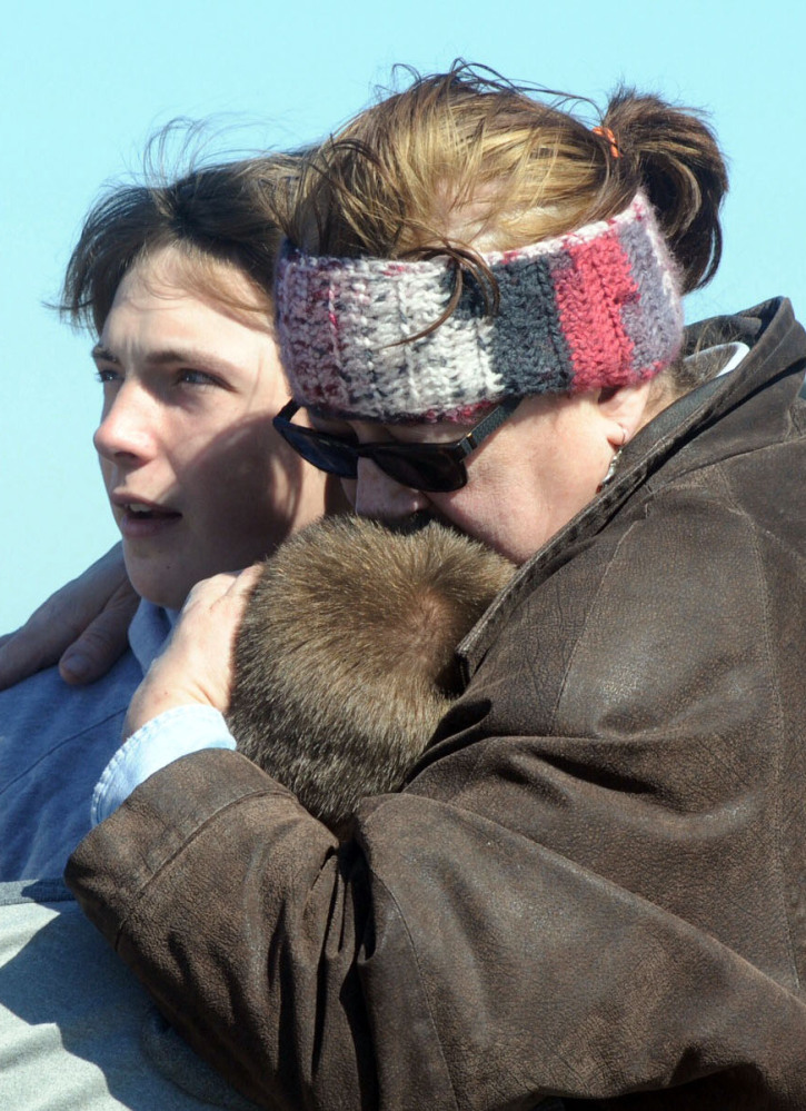 A child is comforted after a school shooting that wounded two students at Madison Local Schools near Middletown, Ohio, Monday.