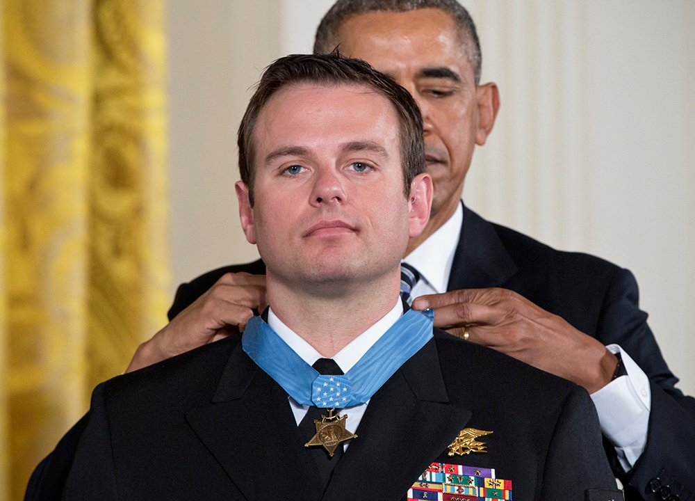 President Barack Obama presents the Medal of Honor to Senior Chief Special Warfare Operator Edward Byers during a ceremony at the White House Monday. The Associated Press