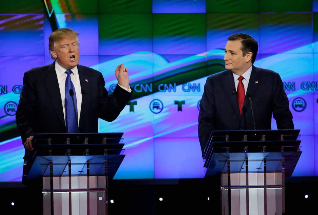 Trump speaks as his rival Ted Cruz looks in Thursday's debate. Cruz and Marco Rubio said that Trump had had to pay a $1 million fine for illegal immigration hiring. The Associated Press