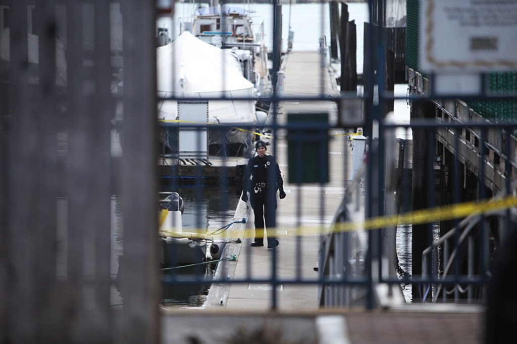 Police have crime scene tape on the Portland waterfront at DiMillo's East Marina where a body was discovered in the water. Jill Brady/Staff Photographer