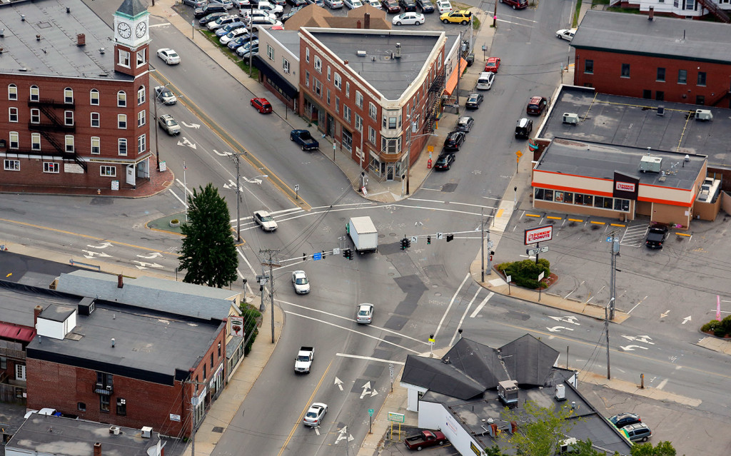 The Woodfords Corner intersection in Portland would become friendlier to pedstrians and businesses under a $2.6 million improvement plan.  2013 Press Herald file photo/Gabe Souza