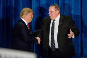 Republican presidential candidate Donald Trump shakes hands with Maine Gov. Paul LePage after LePage introduced Trump at a rally at the Westin Harborview hotel in Portland in March.