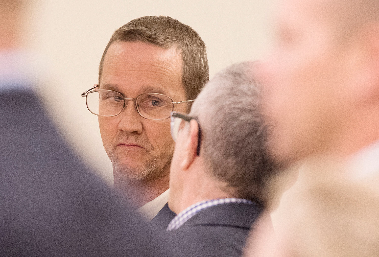 Philip Scott Fournier listens to attorney Jeffrey Silverstein at the Penobscot Judicial Center in Bangor during his initial appearance on a homicide charge in connection with the 1980 death of high school student Joyce McClain.