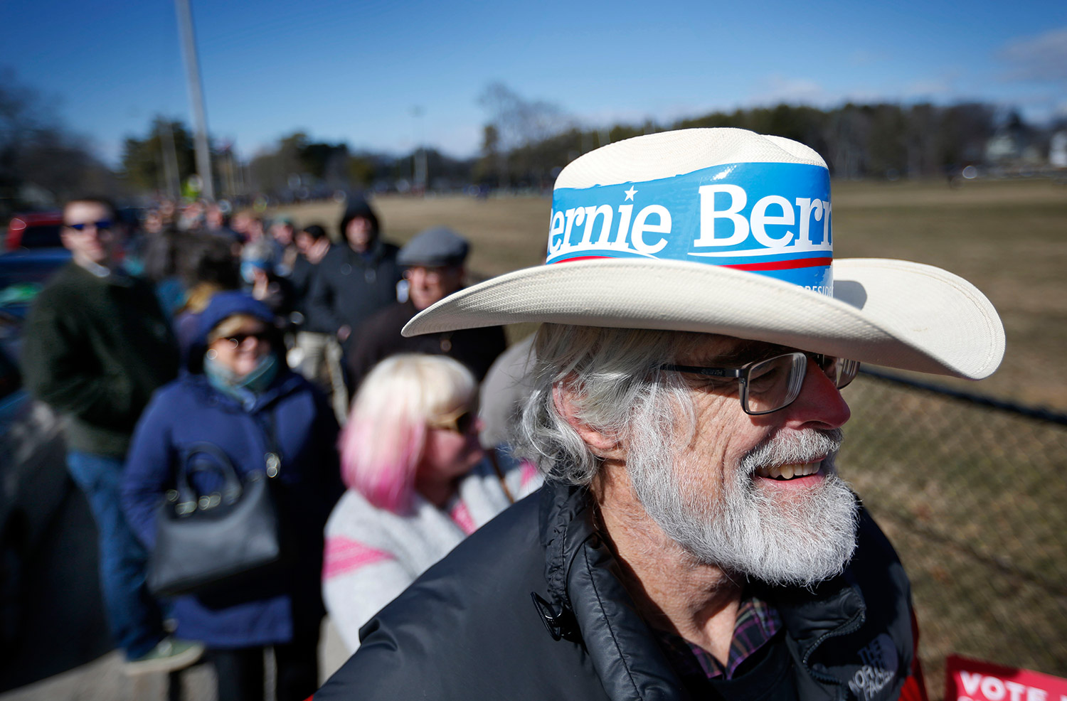 Timothy Wyant, a Bernie Sanders supporters, waits in a line that stretched for more than a half-mile at a Democratic caucus location at Deering High School Sunday. The Associated Press/Robert F. Bukaty