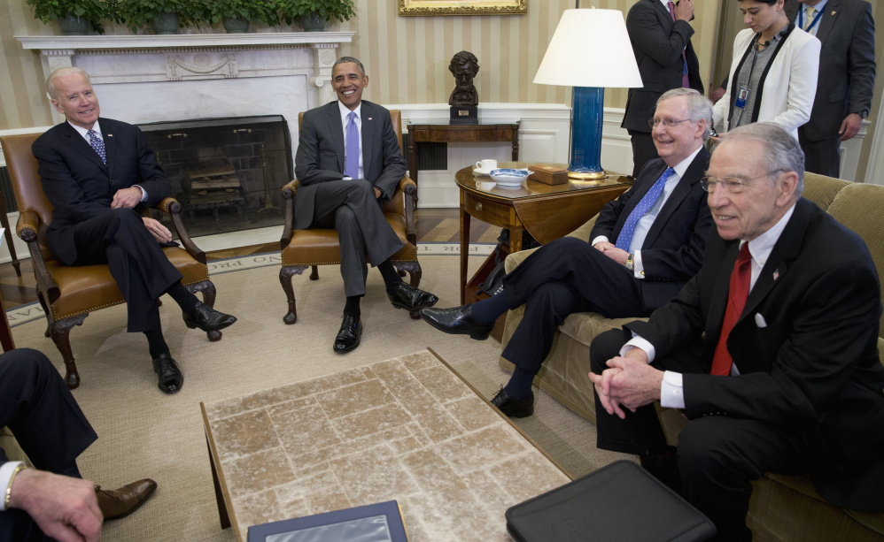 President Barack Obama meets with, from left, Vice President Joe Biden, Senate Majority Leader Mitch McConnell of Kentucky and Senate Judiciary Committee Chairman Sen. Chuck Grassley, R-Iowa, in the Oval Office of the White House on Tuesday to discuss the vacancy in the Supreme Court.