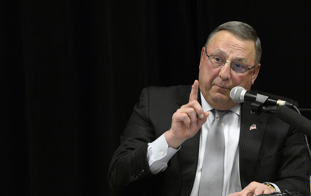 Gov. Paul LePage makes a point as he speaks Tuesday night at Medomak Middle School in Waldoboro. Addressing his support for presidential candidate Donald Trump, LePage said,