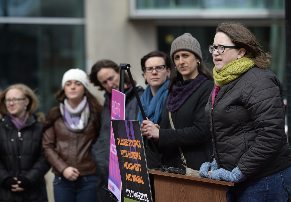 Kate Grogan, far right, of Maine Family Planning in Augusta speaks during Wednesday's rally at Monument Square in Portland.