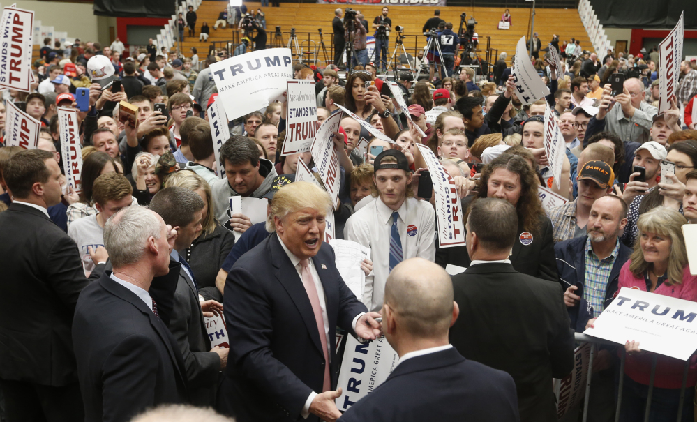 Republican presidential candidate Donald Trump signs autographs during a rally at Radford University in Radford, Va., on Monday. He has won 10 of the 15 primary contests so far, but falls short of the majority of delegates needed to win the Republican nomination.