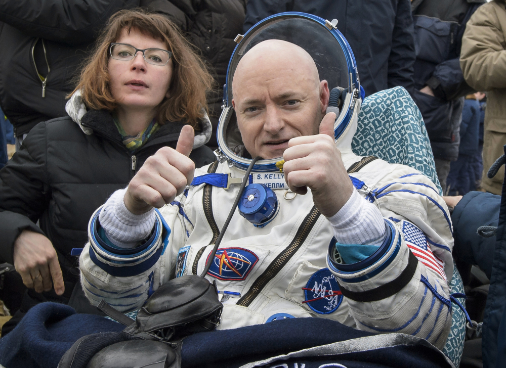 International Space Station crew member Scott Kelly gives the two-thumbs-up sign after landing in Kazakhstan Wednesday.  His 340-day mission was the longest time spent in space by an American.