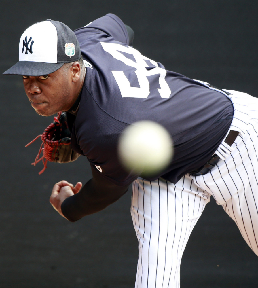 Aroldis Chapman, accused of choking his girlfriend and firing a gun in his garage, won't be available to the New York Yankees for 30 games.