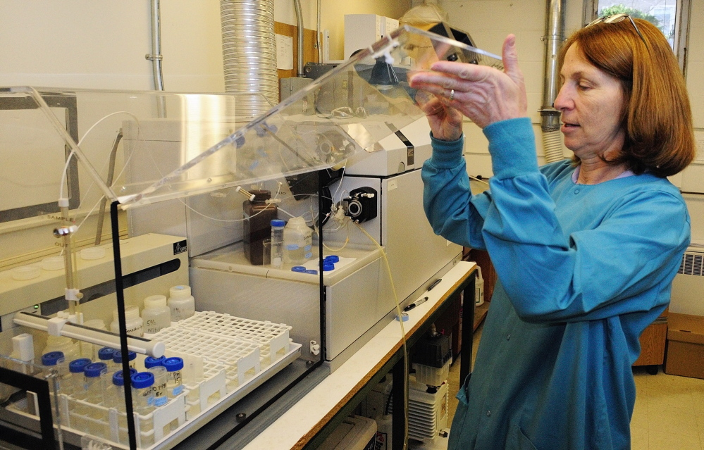 Chemist Cheryl Soucy runs water tests in April 2014 at the Maine Center for Disease Control and Prevention. Soucy uses the inductively coupled plasma mass spectrometer to test water for arsenic and other contaminants.