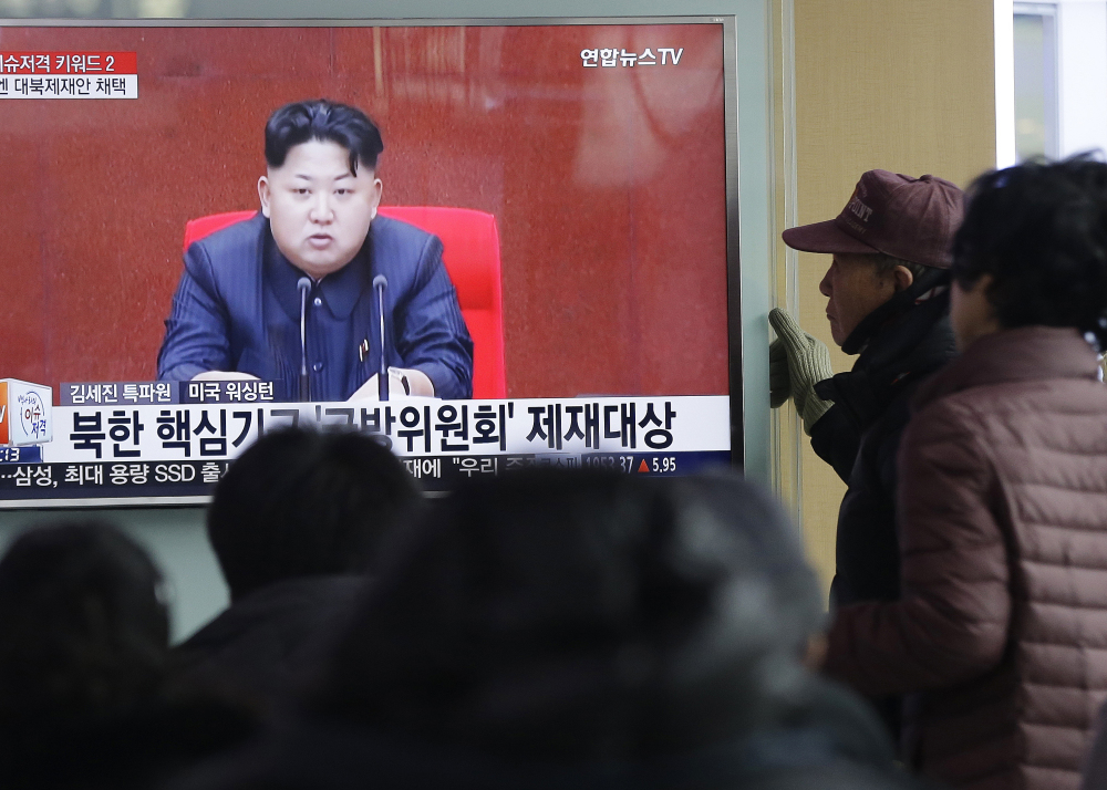 South Koreans watch North Korean leader Kim Jong-un appear on TV in Seoul on Thursday, after the North fired six short-range projectiles into the sea off its east coast.