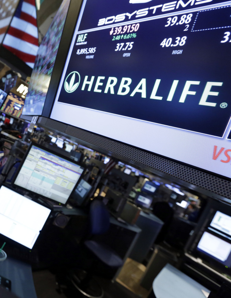 The Herbalife post on the floor of the New York Stock Exchange. Herbalife shares closed Thursday at $52.42, down $3.96, or 7 percent.