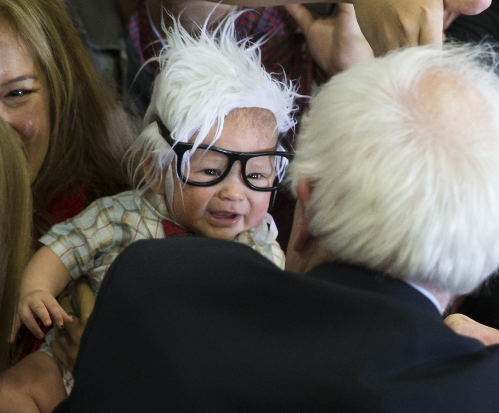 Oliver Jack Carter Lomas-Davis, then 3 months old, comes face-to-face with Sen. Bernie Sanders last month.  The cheerful infant, known as Bernie Baby, died Feb. 25.