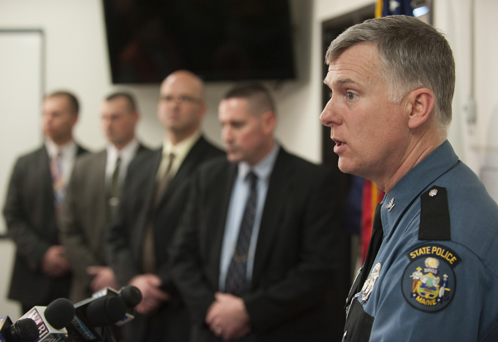 Flanked by detectives, Maine State Police Col. Robert Williams briefs the media on the arrest of Philip Scott Fournier in connection with the 1980 death of high school student Joyce McLain.