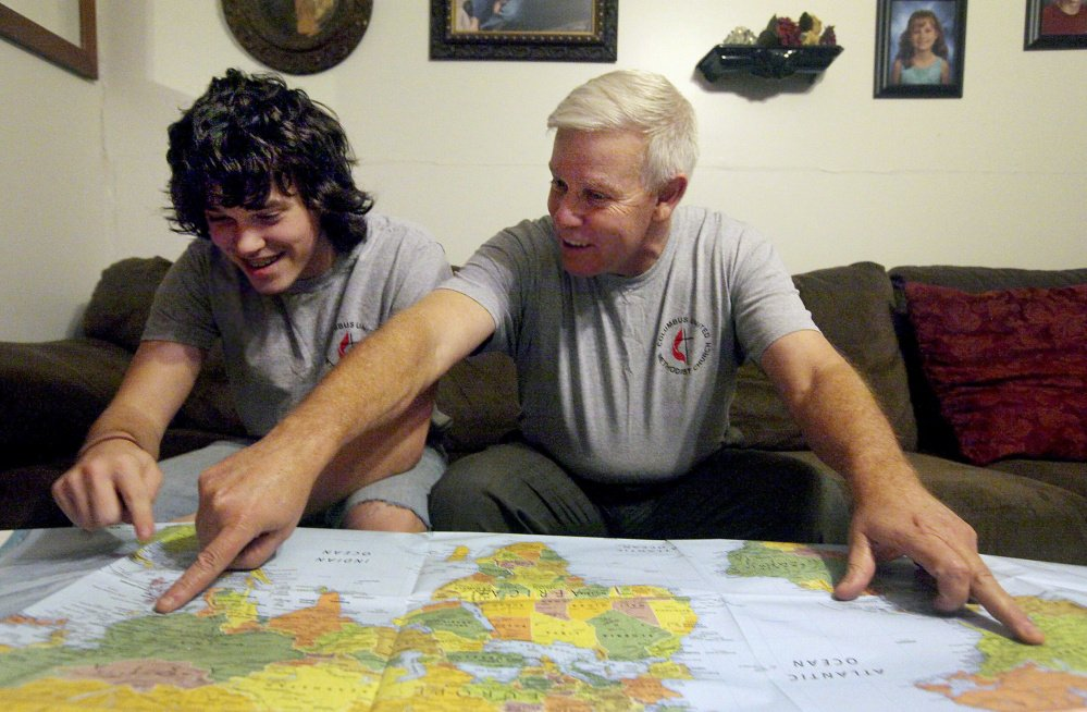"Steve Keppner of Coatsburg, Ill., points out the distance he and his son, Jake, will travel on their upcoming trip to the Philippines. ""I couldn't let him go alone,"" Steve said. The Associated Press"