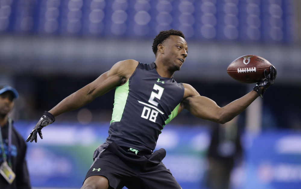 In this Feb. 29, 2016, file photo, Ohio State defensive back Eli Apple runs a drill at the NFL football scouting combine in Indianapolis.  The Associated Press