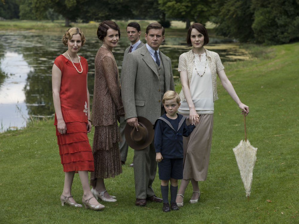 Laura Carmichael as Lady Edith, left, Elizabeth McGovern as Cora, Countess of Grantham, Matthew Goode as Henry Talbot, Allen Leech as Tom Branson, Zac Barker as Master George and Michelle Dockery as Lady Mary.