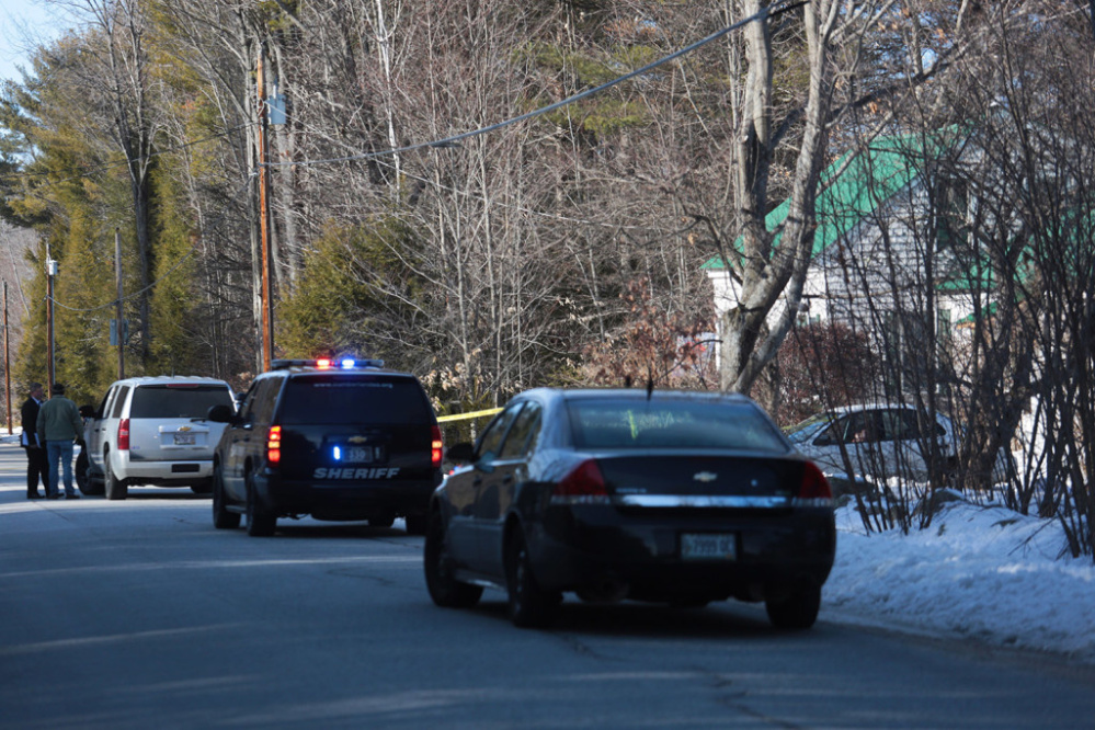 Police vehicles converge at the scene of a fatal shooting at 331 Hancock Pond Road in Sebago on Saturday.