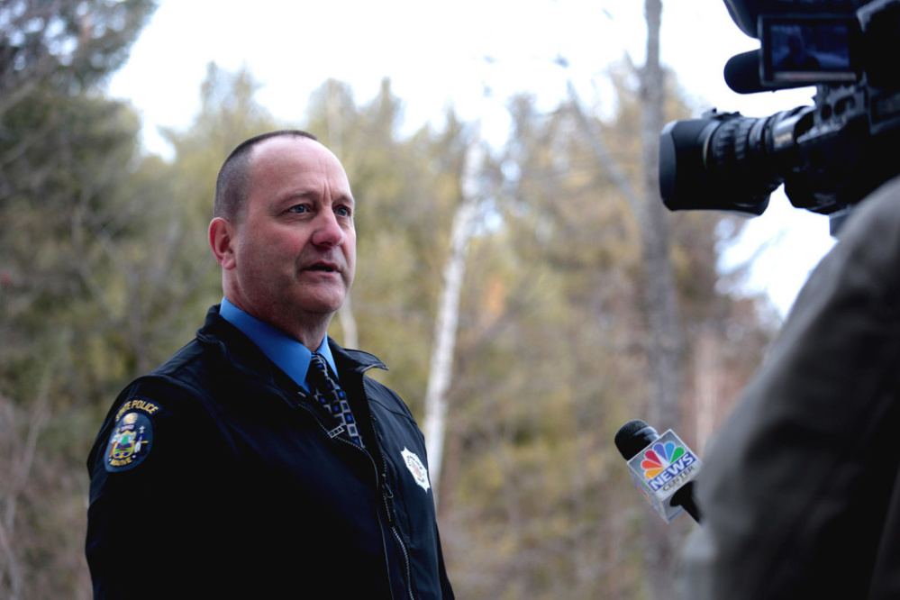 Maine State Police Sgt. Chris Harriman speaks too the media about a fatal shooting at 331 Hancock Pond Road in Sebago on Saturday.
