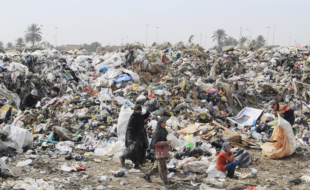Iraqis search for recyclables at a Baghdad dump where most workers are widows and orphans living further and further below a lengthening poverty line.