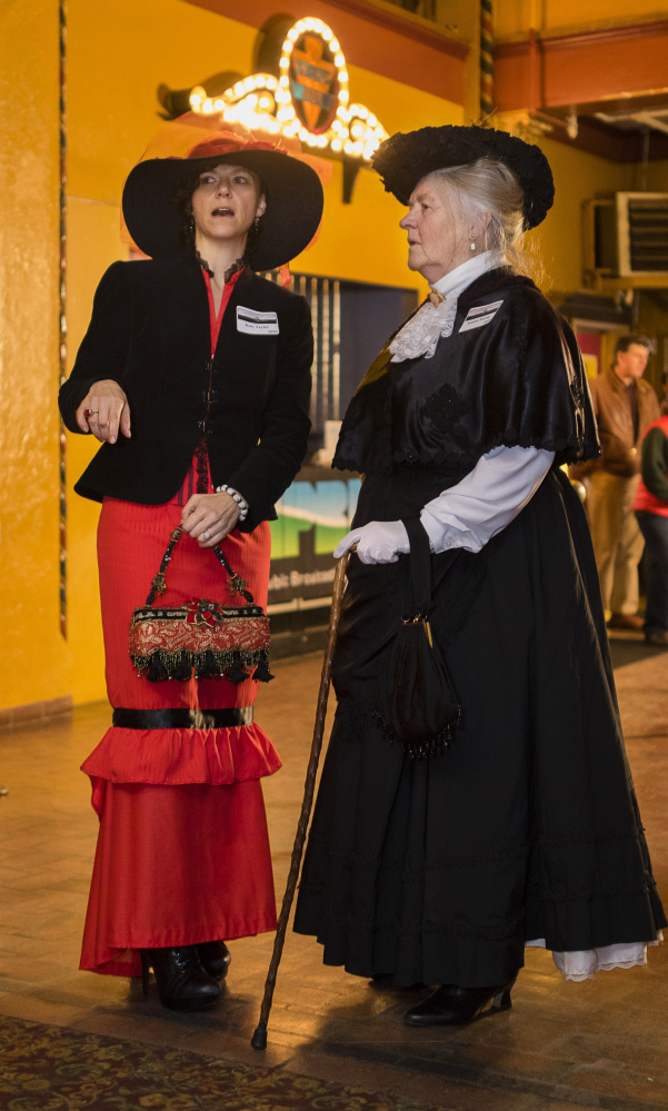 Katy Taylor of Bath and Sandra Martin of Topsham wear Victorian-era clothing for the