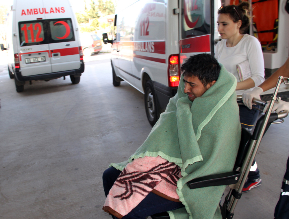 Medics care for a rescued migrant at a hospital in Didim, Turkey, on Sunday. Turkey's state-run news agency said 25 migrants drowned off Turkey while trying to reach Greece.