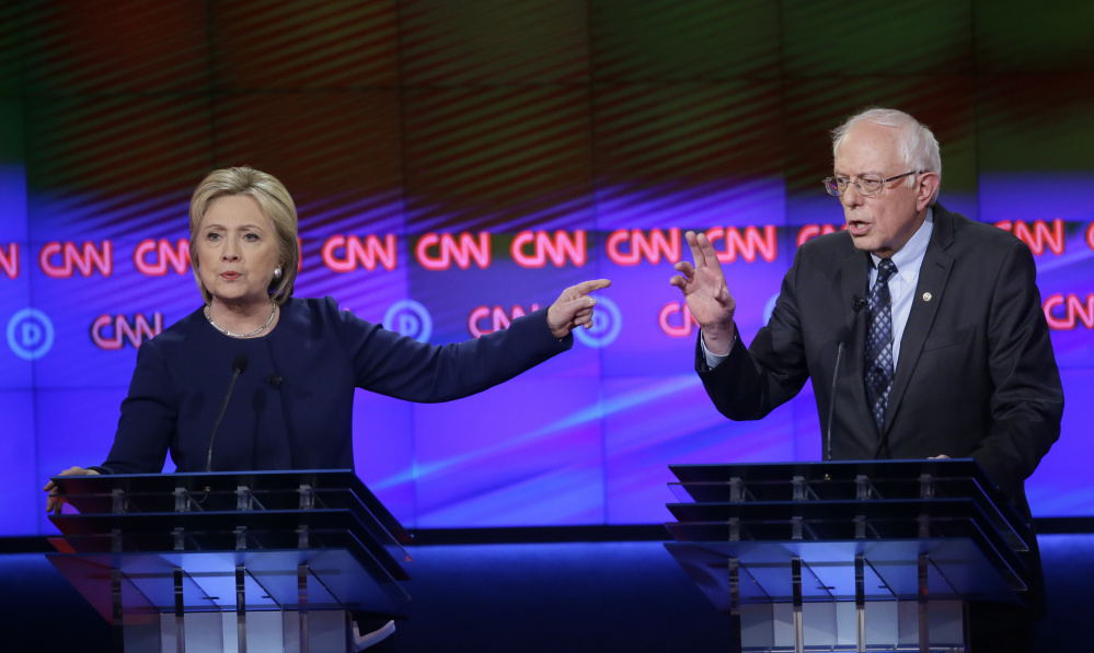 Democratic presidential candidates Hillary Clinton and, Sen. Bernie Sanders, I-Vt., argue a point during a Democratic presidential primary debate at the University of Michigan-Flint on Sunday.