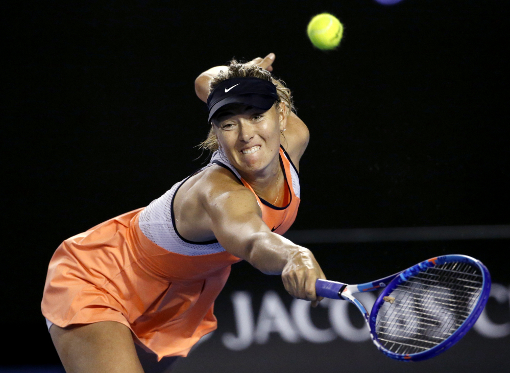 In this Jan. 20, 2016, file photo, Maria Sharapova of Russia reaches for a backhand return to Aliaksandra Sasnovich of Belarus during their second round match at the Australian Open tennis championships in Melbourne, Australia.