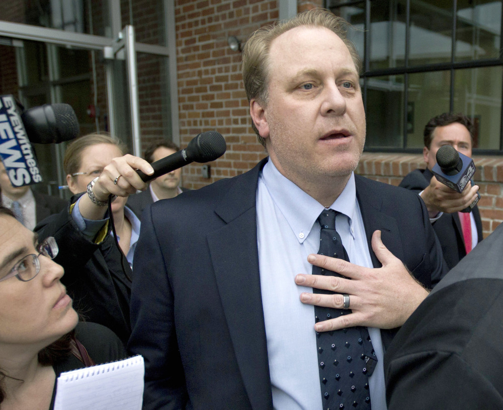 Former Boston Red Sox pitcher Curt Schilling, center, is being sued by the Rhode Island economic development agency.