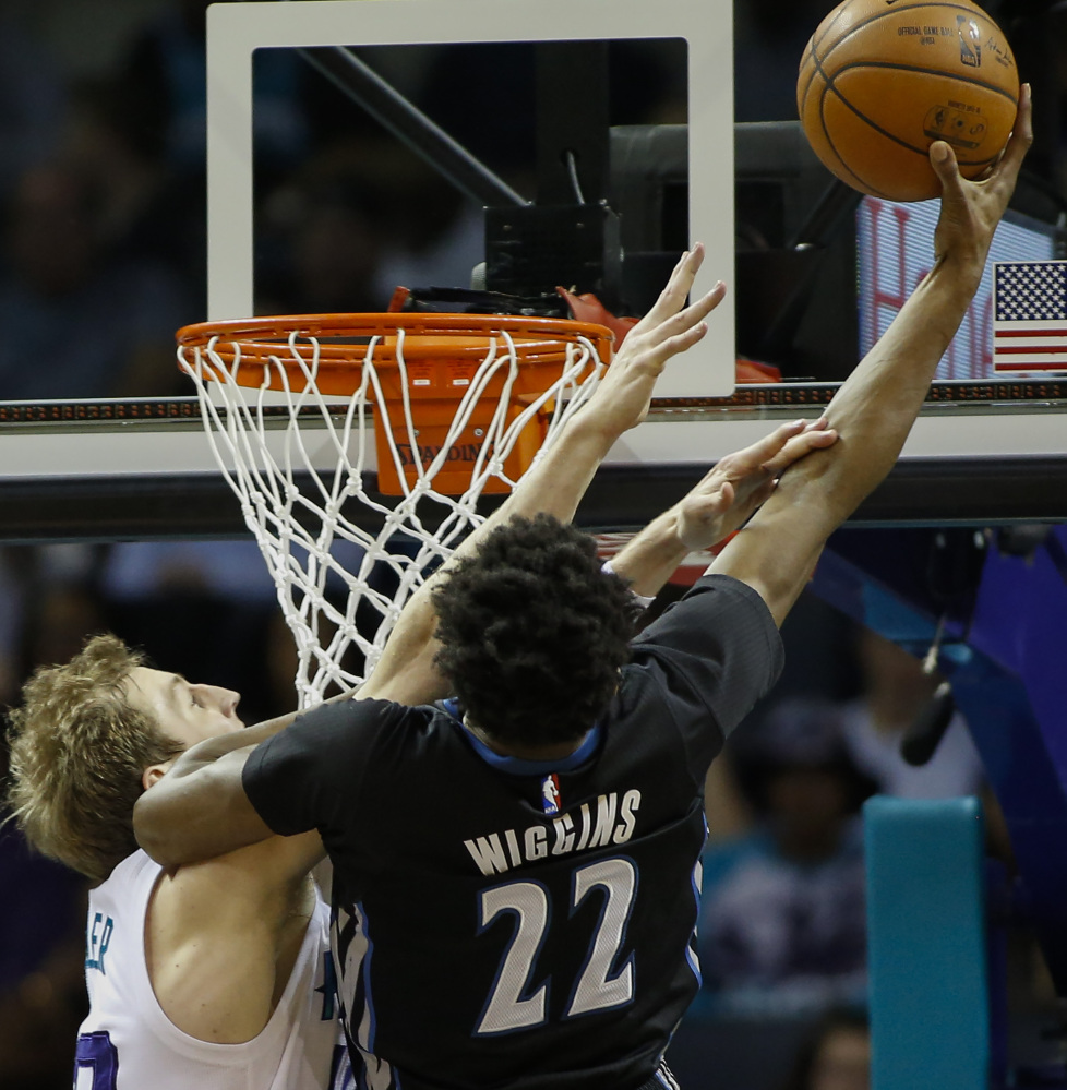 Andrew Wiggins of the Minnesota Timberwolves shoots over Cody Zeller of the Charlotte Hornets in the first half of Charlotte's 108-103 victory Monday night.