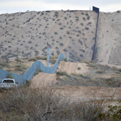 A U.S. Border Patrol agent drives near the U.S.-Mexico border fence in Sunland Park, N.M., in January 2016.
