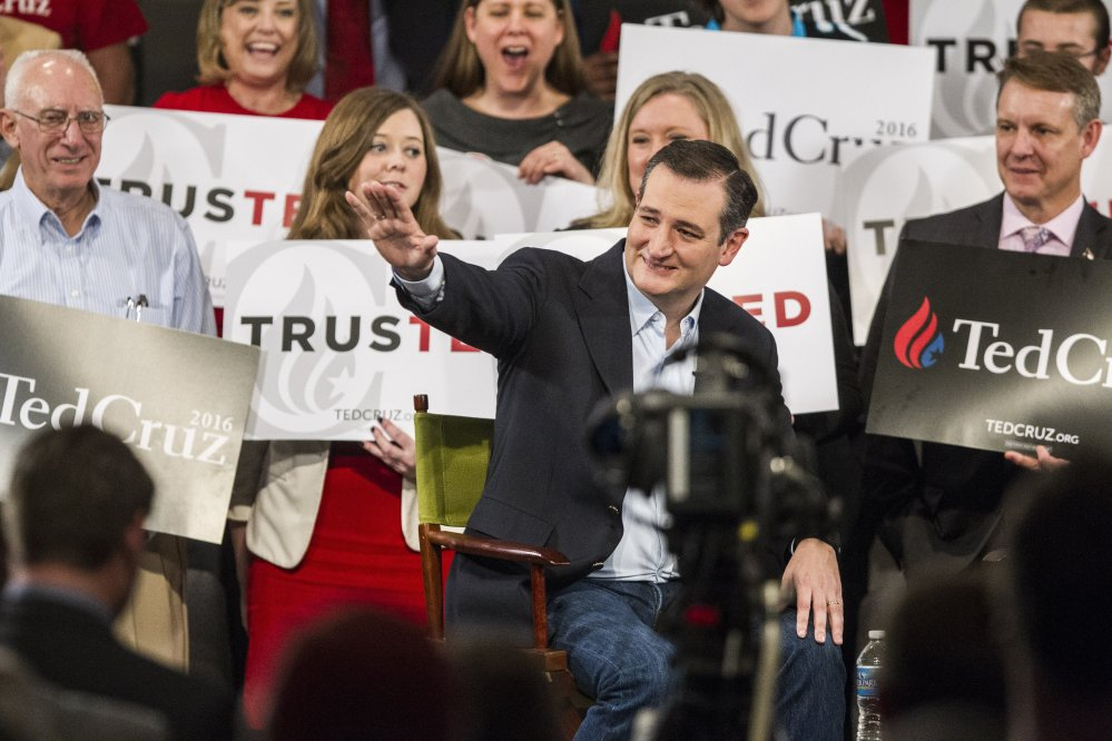 Republican presidential candidate Sen. Ted Cruz, R-Texas, waves to the crowd during a campaign rally Tuesday at Calvary Baptist Church in Raleigh, N.C.