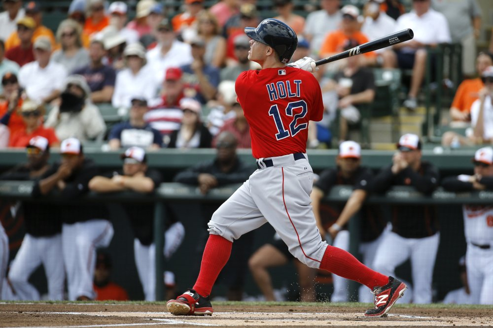 Brock Holt of the Red Sox watches his solo home run in the first inning of Boston's 5-1 win over Baltimore on Tuesday in Sarasota, Florida.