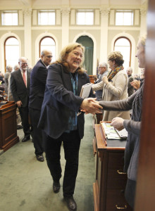 Chief Justice Leigh Saufley shakes hands with members of the Legislature after delivering her annual State of the Judiciary address at the State House in Augusta on Wednesday.
