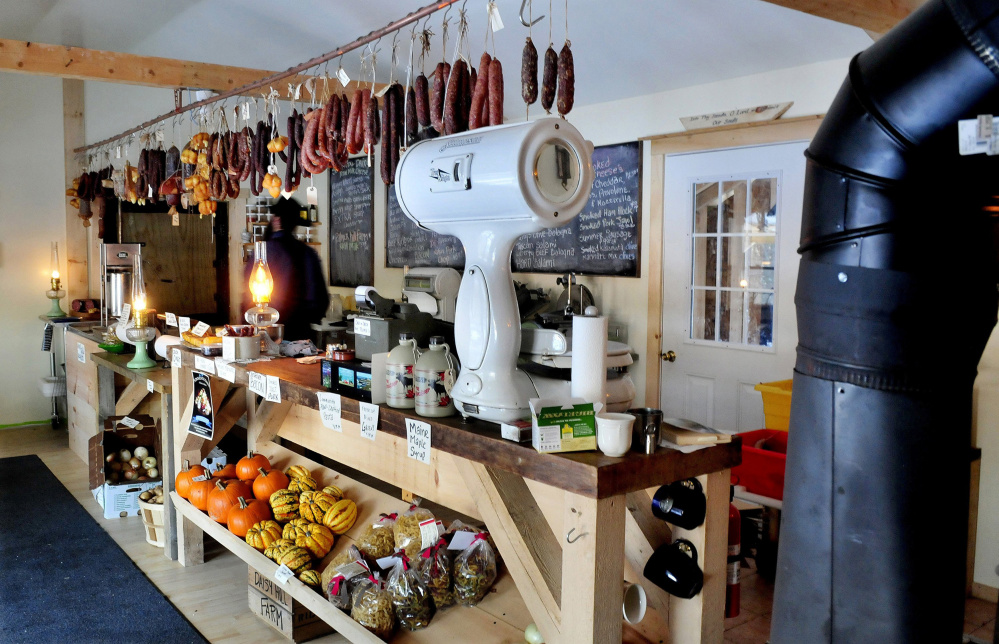 Smoked meats and cheeses and fresh vegetables are offered at the Charcuterie shop in Unity. The owner is working with state regulators to comply with food codes, a challenge because of the lack of electricity and technology at the shop.