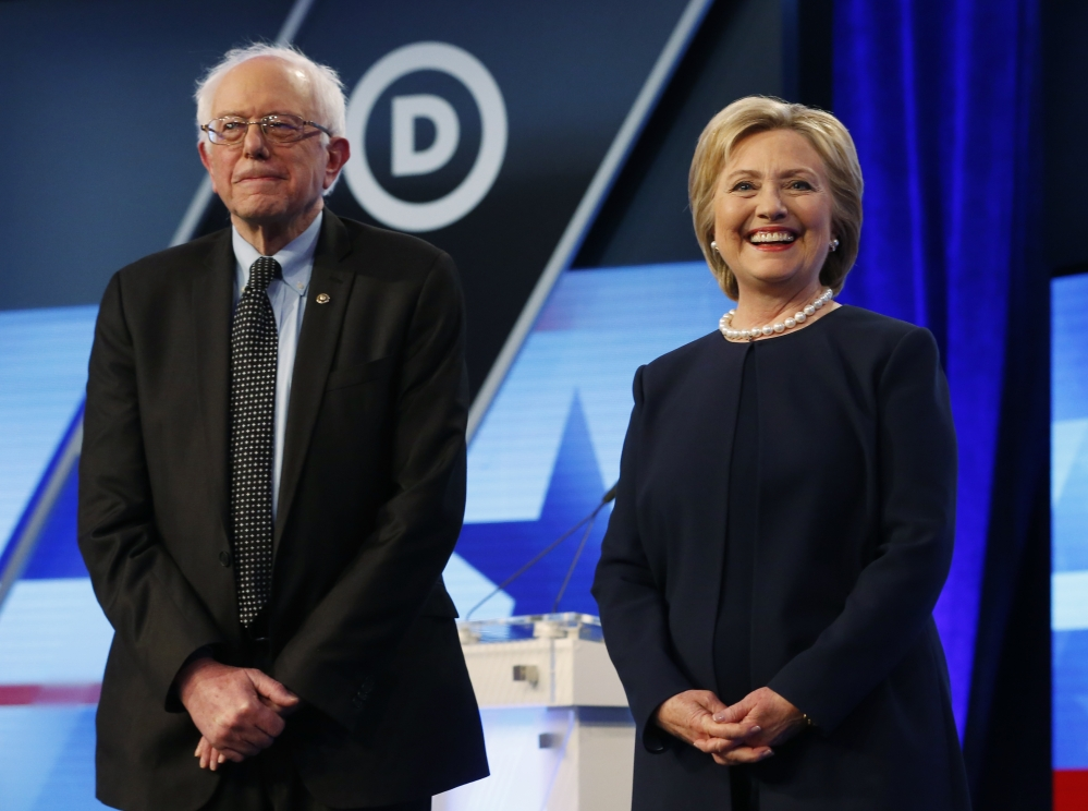 Democratic presidential candidates, Hillary Clinton and Sen. Bernie Sanders, I-Vt,  stand together before the start of the Univision, Washington Post Democratic presidential debate at Miami-Dade College,  Wednesday, in Miami, Fla.