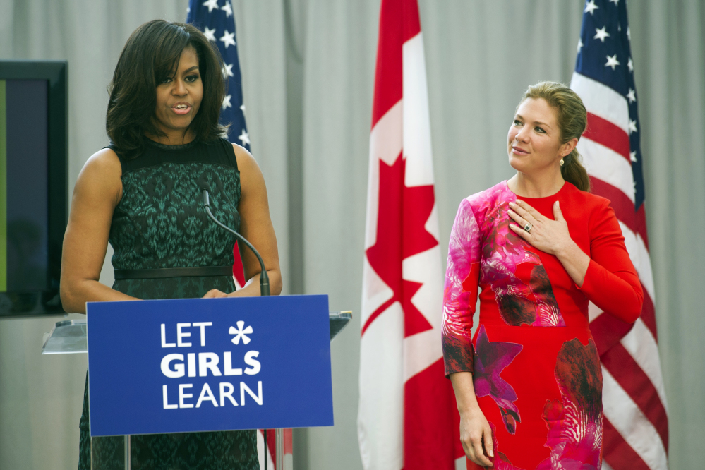 First lady Michelle Obama introduces Sophie Grégoire-Trudeau, wife of Canadian Prime Minister Justin Trudeau, to speak as they participate in a program at the U.S. Institute of Peace in Washington on Thursday to highlight Let Girls Learn efforts and raise awareness for girls' education worldwide.