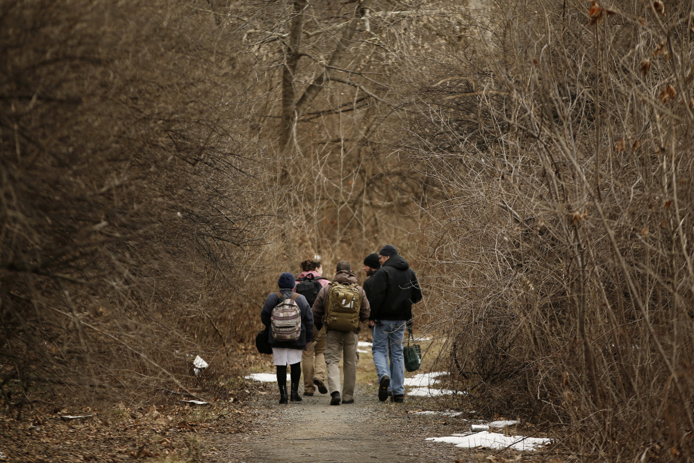 Medical assistant Lina Marin, from left, registered nurse Laura Lacroix, physician assistant Brett Feldman, military healthcare consultant Zach Laudenslager and community outreach specialist Bob Rapp walk to visit a homeless camp in Bethlehem, Pa.