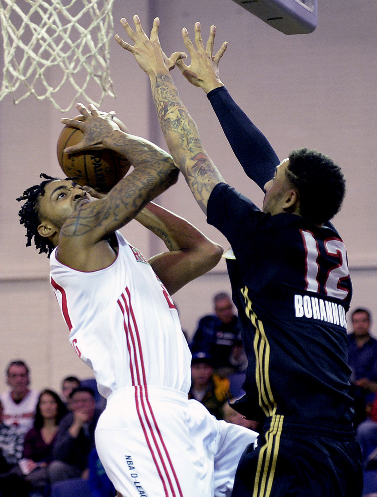 Maine's James Young drives to the basket against Erie's John Bohannon during the Red Claws' on Thursday at the Portland Expo. Young scored 12 points and grabbed eight rebounds.