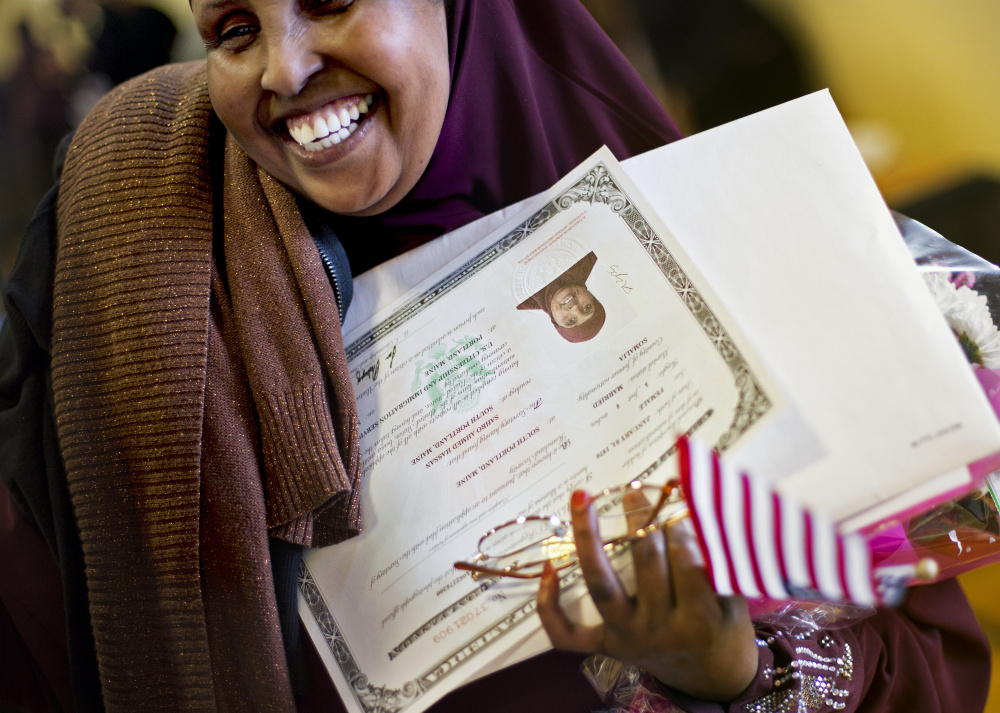 Sahro Hassan, 46, of South Portland, originally from Somalia, smiles after receiving her certificate of U.S. citizenship following a ceremony in Portland on Friday.