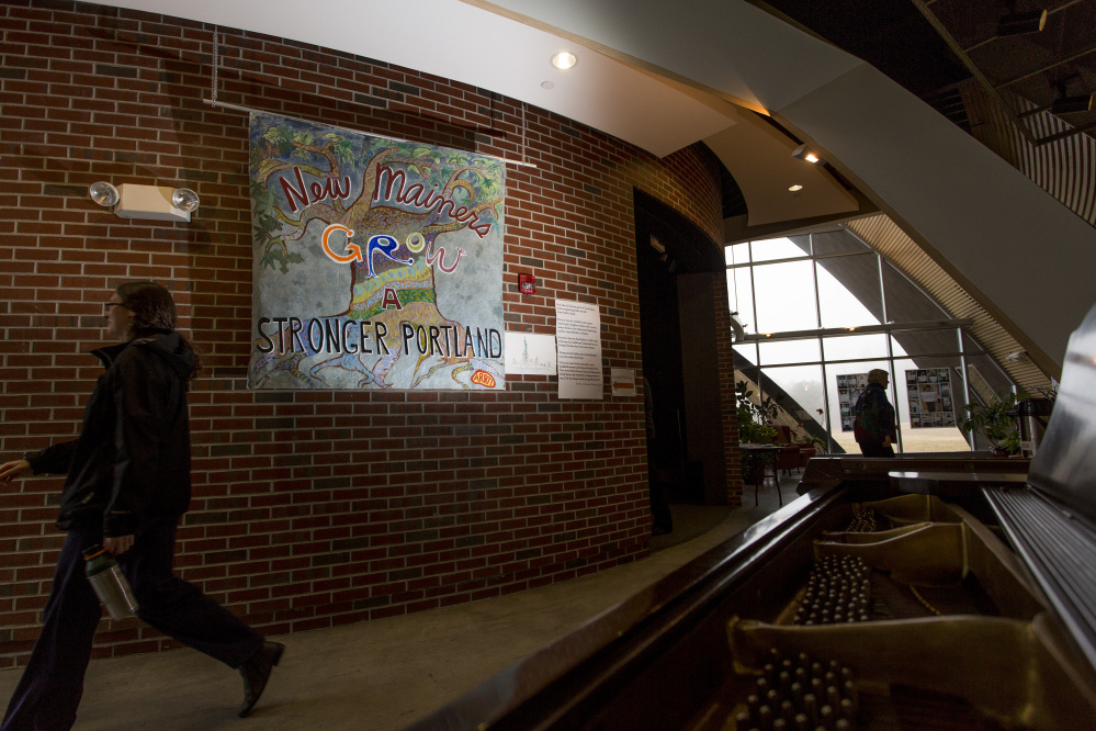 "A poster here, seen in the main hallway reads "" New Mainers Grow a Stronger Portland."" Gabe Souza/Staff Photographer"