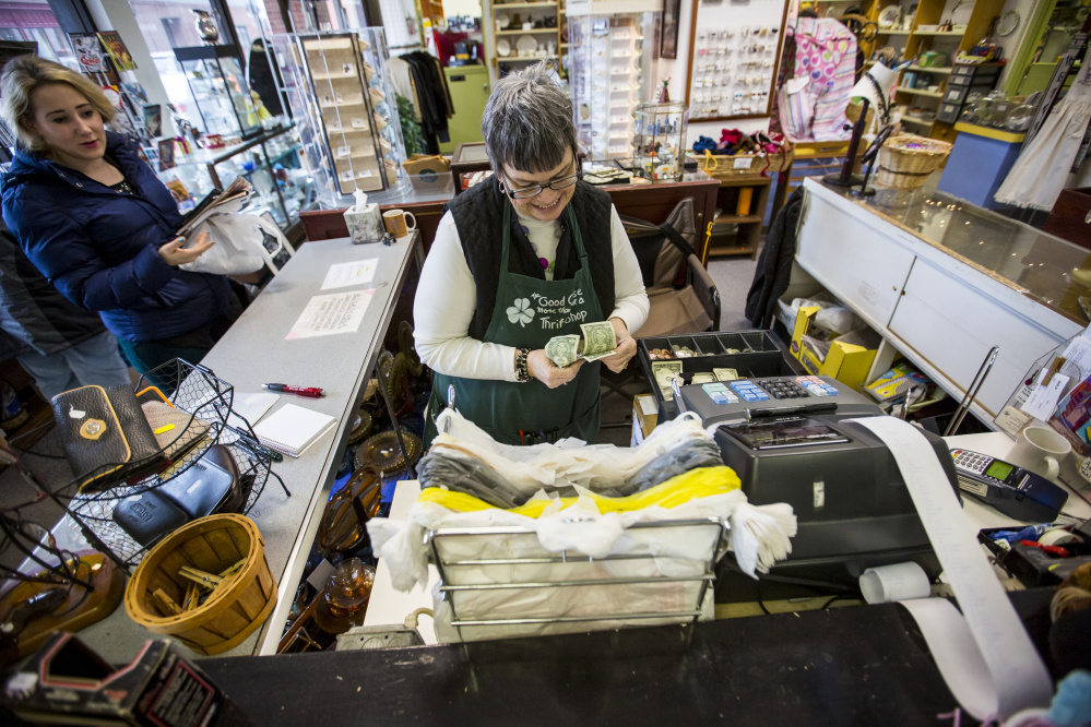 Katie Guzman, a longtime employee of Good Cause Thrift Shop in Portland, makes change for a customer. The shop got a reprieve after announcing it would have to close because it lost the support of Catherine McAuley High School. People rallied, donations poured in and the 22-year-old thrift store announced Thursday it would remain open. The store will now be aligned with Mercy Healthcare Foundation and renamed Still the Good Cause. Ben McCanna/Staff Photographer