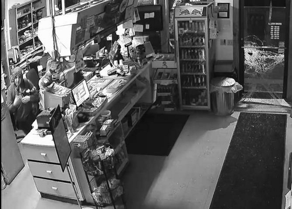 One of three burglars who broke into the Flying Point Variety store in Mount Vernon on Thursday is shown at left. The trio broke the door at right to get in.