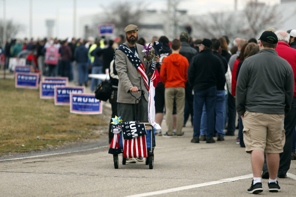 Supporters line up outside the Wright Brothers Aero Hangar for a rally by Republican presidential candidate Donald Trump on Saturday in Vandalia, Ohio.