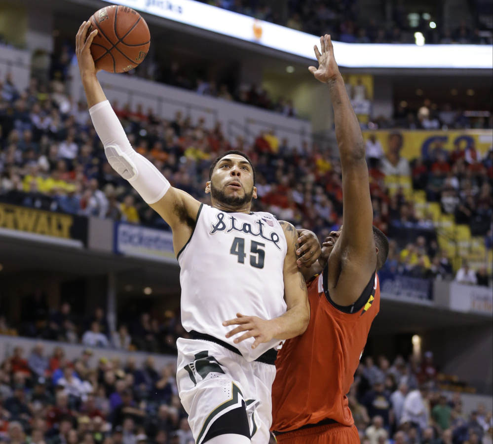 Michigan State's Denzel Valentine hits for two points against Maryland's Diamond Stone during a 64-61 win by the Spartans in the semifinals of the Big Ten Conference tournament at Indianapolis on Saturday.