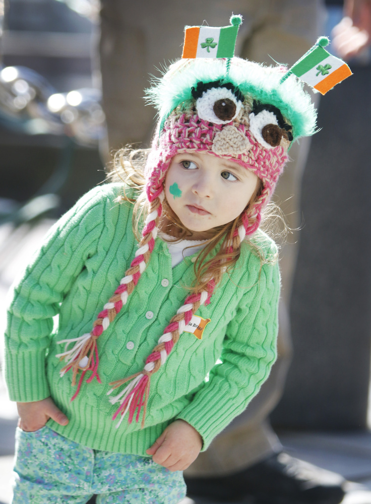 PORTLAND, ME - MARCH 13: Charlotte Geoghan, 3, of Falmouth watches as the St. Patrick's Day parade passes by along Commercial Street in Portland. (Photo by Jill Brady/Staff Photographer)