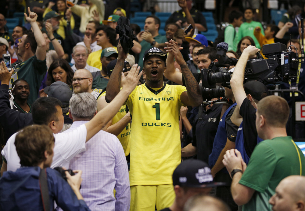 Oregon forward Jordan Bell celebrates with fans after Oregon defeated Utah on Saturday. The Ducks, who finished 28-6, were named a No. 1 seed for the NCAA tournament. The Associated Press