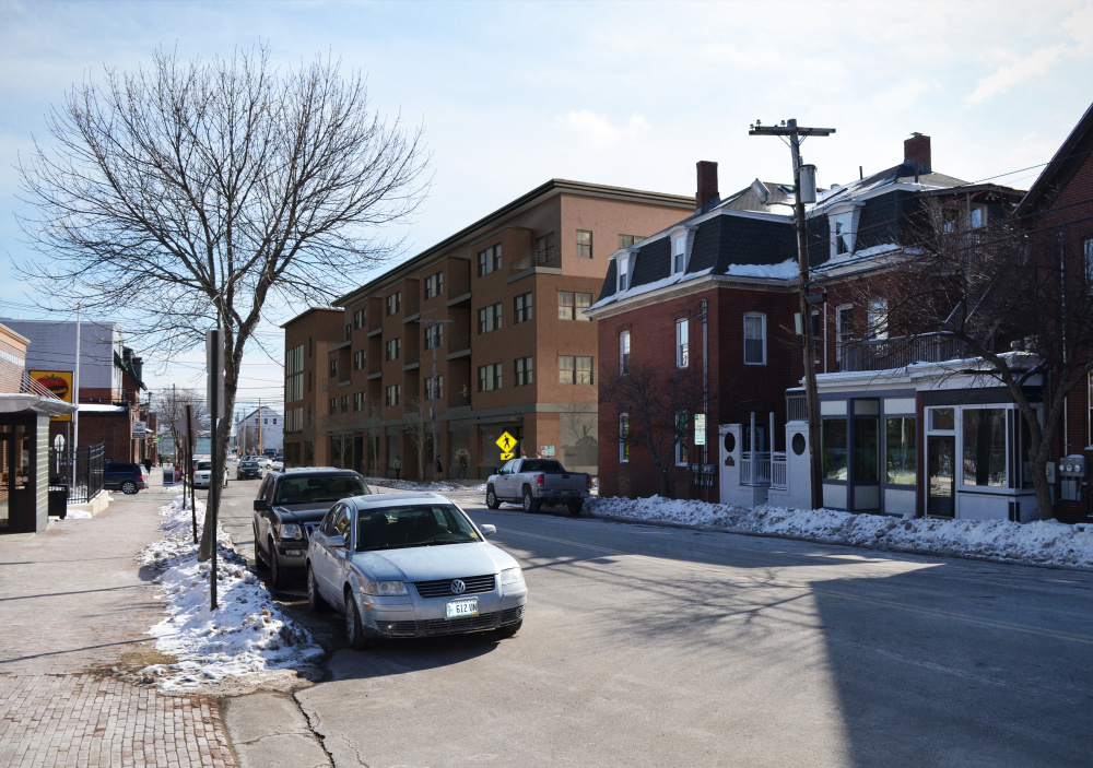 The four-story condominium project, depicted at rear, would require the demolition of Port City Glass at 62 India St.